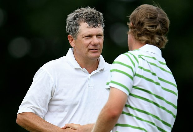 Tim Jackson congratulates Charlie Holland after their match during Thursday's Round of 32 at Southern Hills Country Club in Tulsa, Okla.