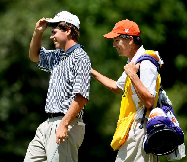 Ben Martin with his father/caddie Jim, after they won their match.