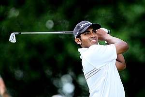 Bhavik Patel watches his tee shot at No. 6.