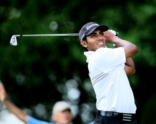 Bhavik Patel watches his tee shot at No. 6.