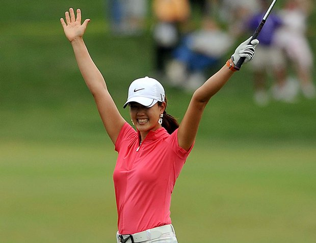 Michelle Wie reacts after chipping in for birdie on the 18th hole during the first round of the Safeway Classic.