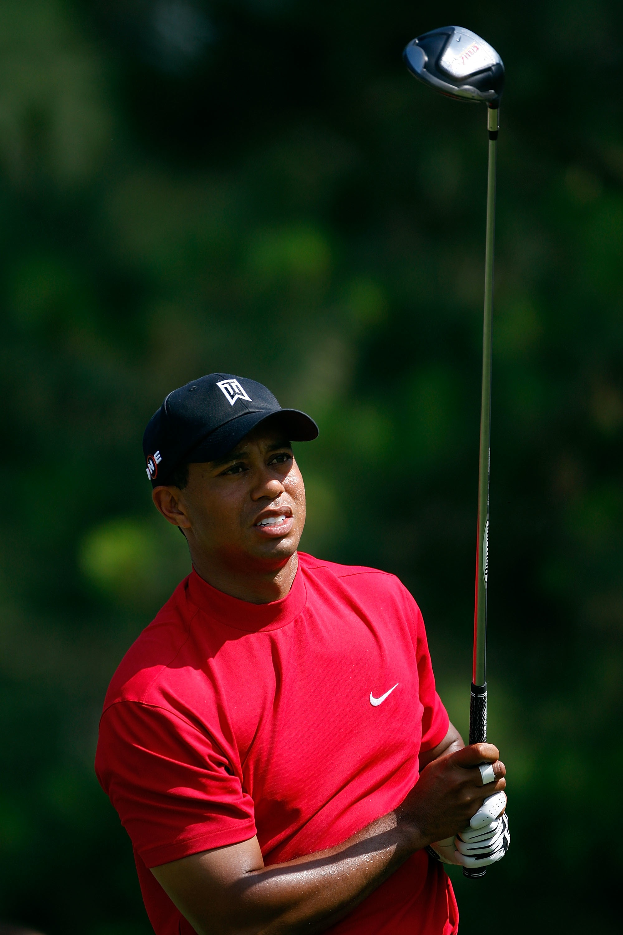 Tiger Woods watches his tee shot on the ninth hole during the final round of THE PLAYERS Championship.
