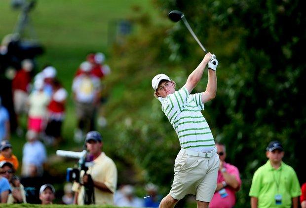 Charlie Holland hits his tee shot at No. 13.