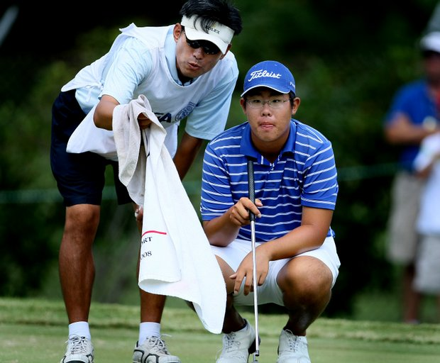 Byeong-Hun An and his caddie/father, Jae-Hyung An, at No. 14.