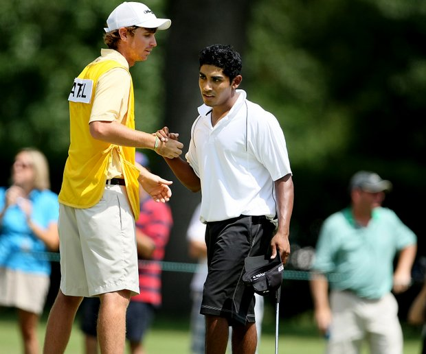 Bhavik Patel, right, and his caddie Chris Beall shake hands after Saturday's semifinals.
