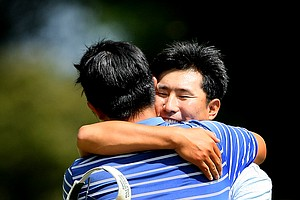 Jae-Hyung An gives his son Byeong-Hun An a hug after defeating Bhavik Patel during Saturday's semifinals.