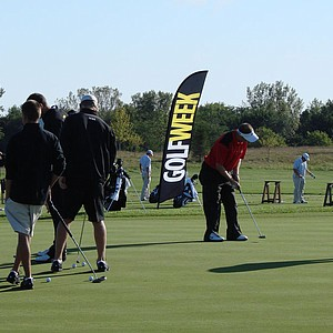 Players practice on the putting green at Blue Top Ridge.