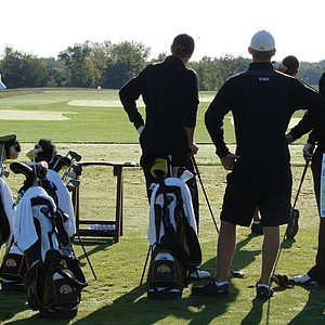 Iowa practices on the driving range at Blue Top Ridge.