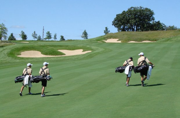 South Florida walks up the 15th fairway at Blue Top Ridge.