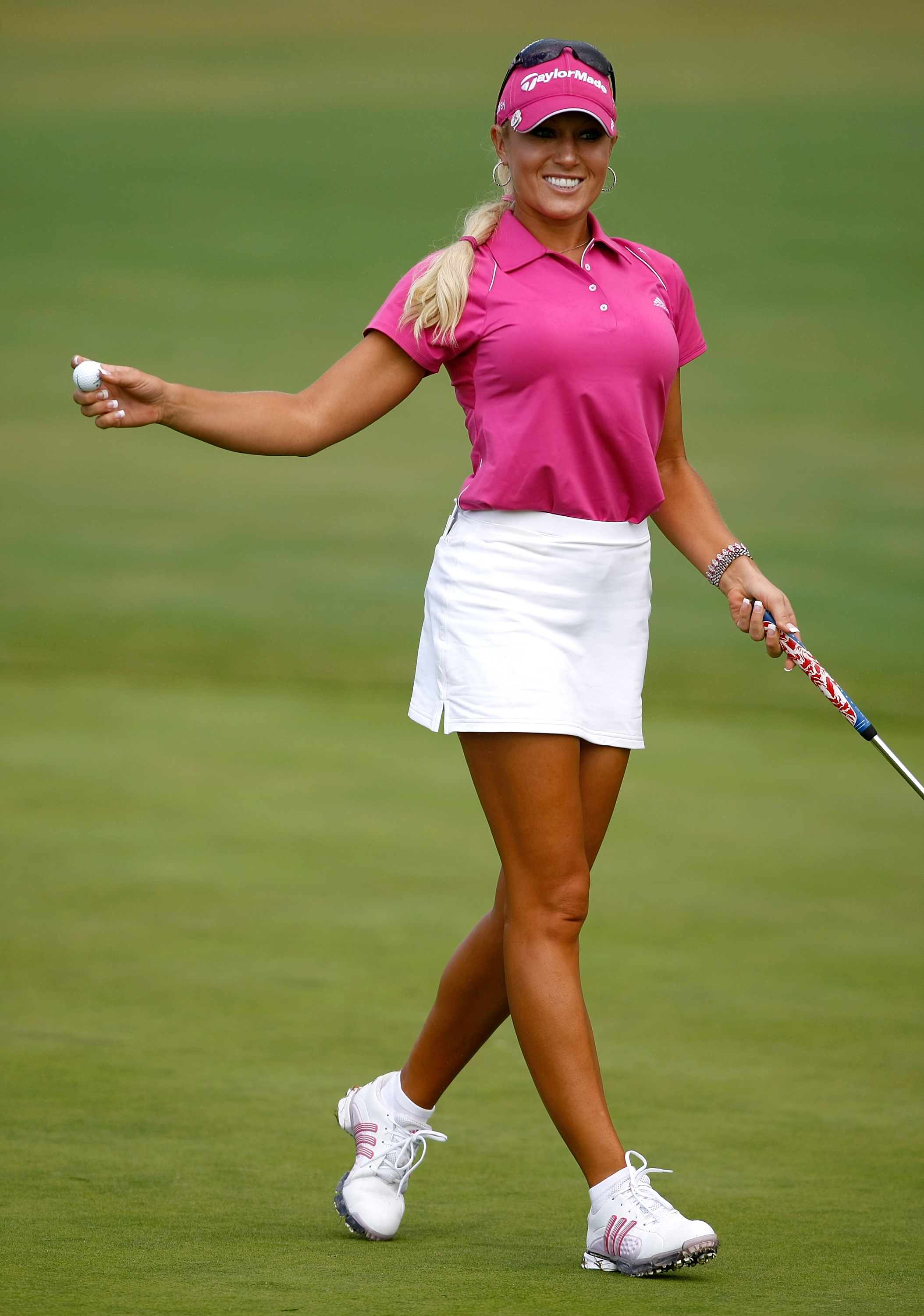 Natalie Gulbis walks off the 18th green after the second round of the Safeway Classic.