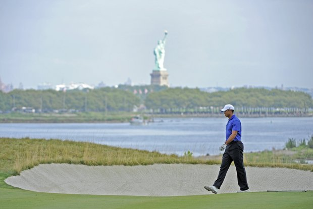 Tiger Woods walks up the 18th fairway during the third round of The Barclays.