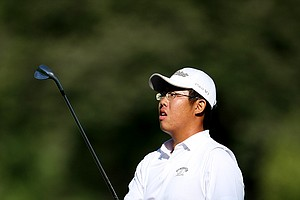 Byeong-Hun An hits a shot from the fairway at No. 9 in the morning round.