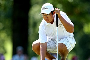 Byeong-Hun An lines up his putt at No. 17 in the morning round.
