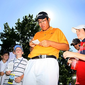Byeong-Hun An signs his autograph for fans after winning the U.S. Amateur at Southern Hills Country Club.