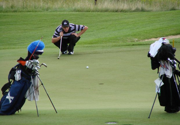 Tim Madigan of New Mexico State lines up a putt at Golfweek's Conference Challenge.