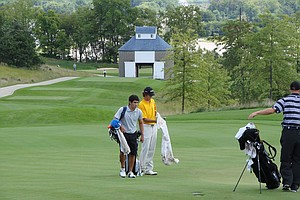 Xavier's Sebastian MacLean walks to the 15th hole at Blue Top Ridge at Golfweek's Conference Challenge.