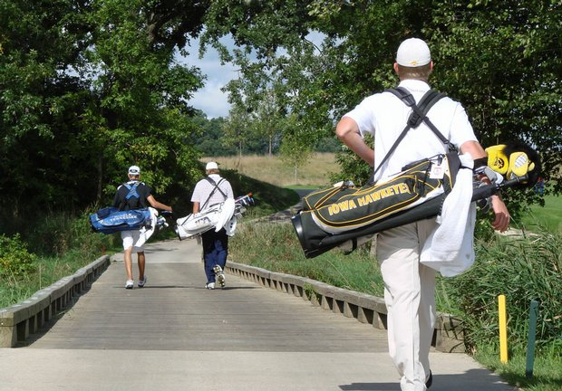 Players walks across a bridge at Blue Top Ridge during Golfweek's Conference Challenge.