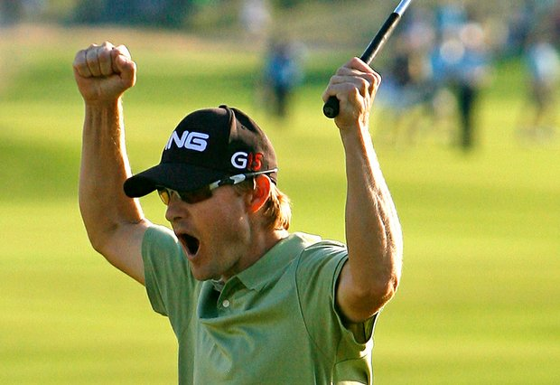 Heath Slocum reacts after sinking his par putt on the 18th green to win The Barclays.