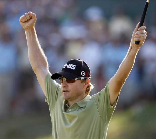 Heath Slocum celebrates a 20-foot par putt on the 18th green Sunday at The Barclays.