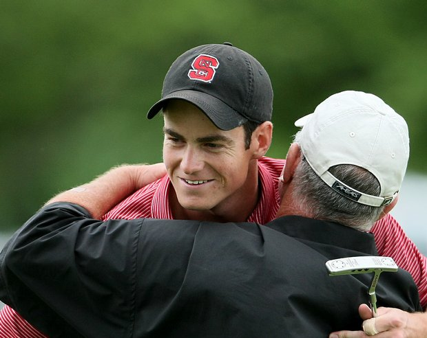 Matt Hill is congratulated by head coach Richard Sykes after winning the 2009 NCAA individual title.