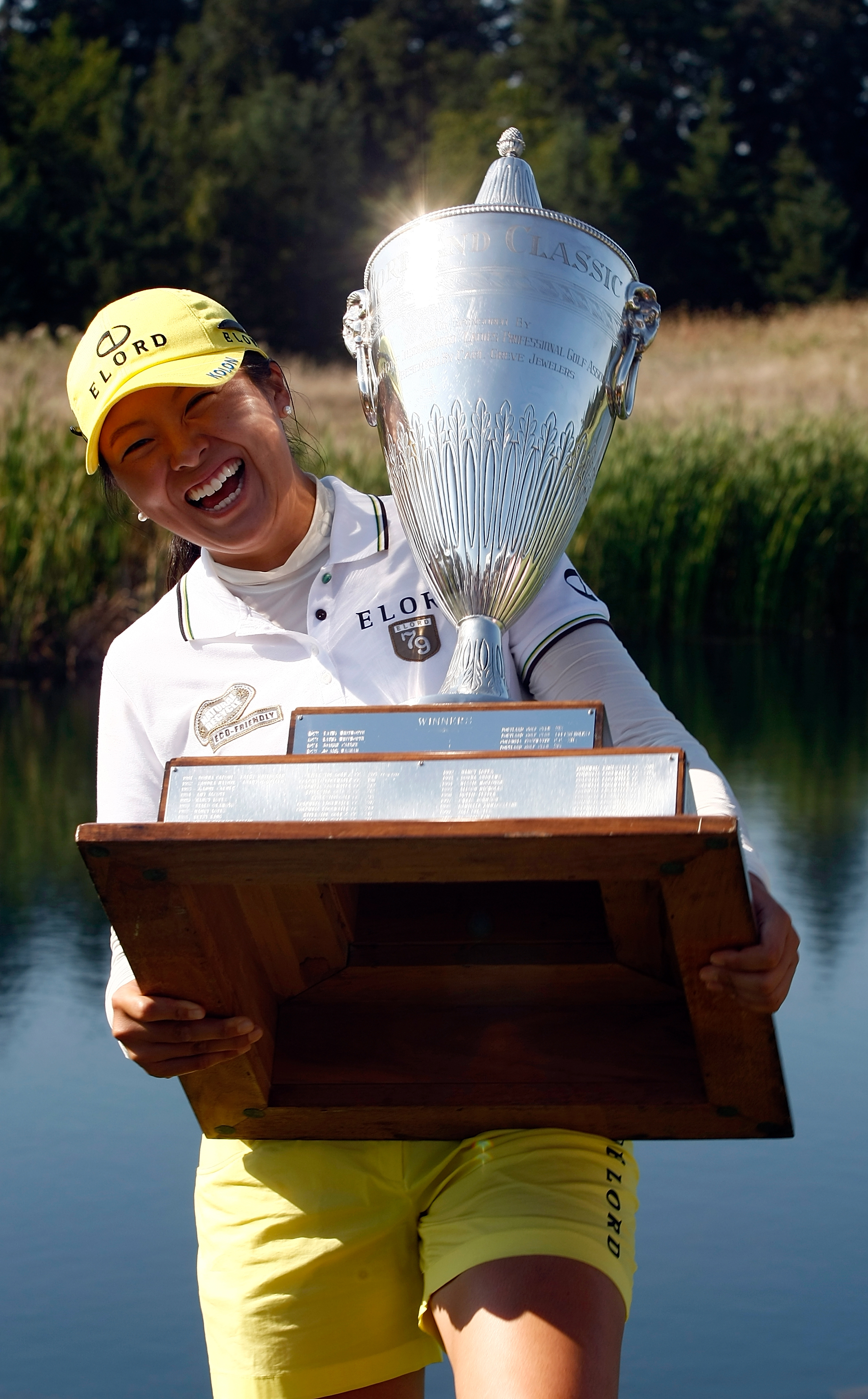 M.J. Hur poses with the trophy after winning the Safeway Classic.