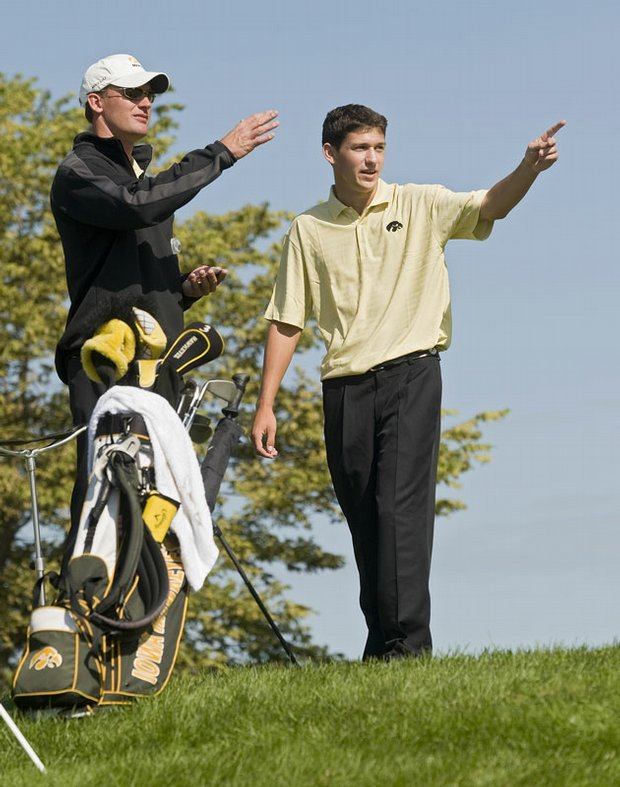 Iowa junior Brad Hopfinger confers with coach Mark Hankins during the second round of Golfweek's Conference Challenge.