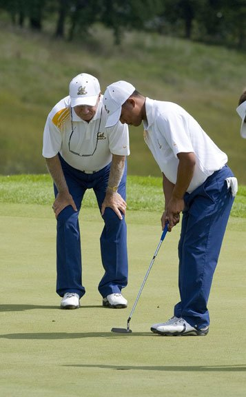 Cal coach Steve Desimone helps his Golden Bear line up a putt during the second round of Golfweek's Conference Challenge.