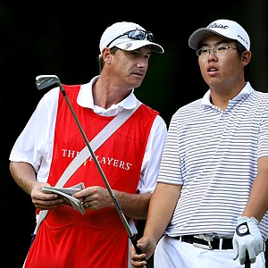 Byeong-Hun An talks with his caddie at No. 8.