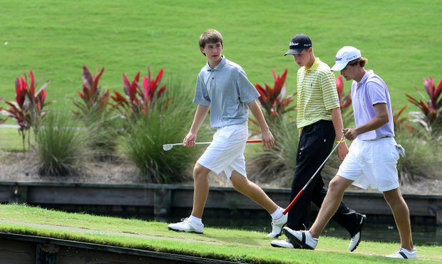 The final group of the day from left to right, Oliver Schniederjans, Patrick Rodgers and Bobby Wyatt walk to No. 17.