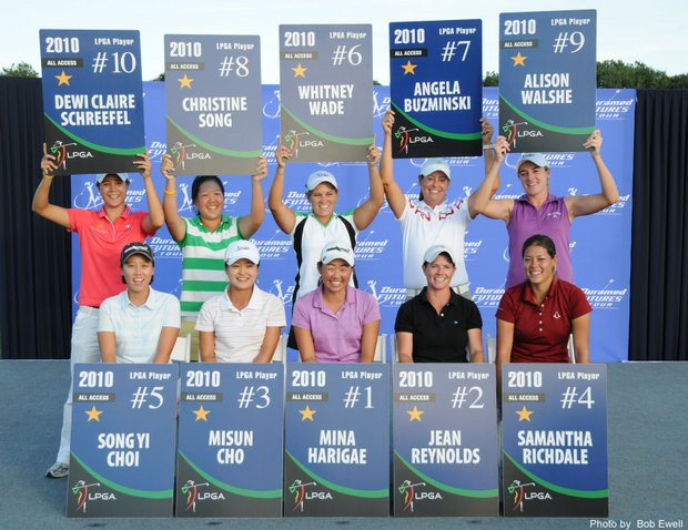 Players show off their 2010 LPGA cards at the season-ending Duramed Futures Tour event.