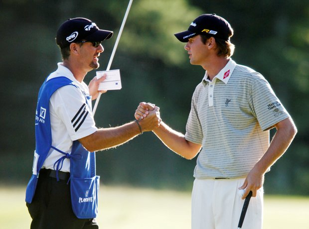 Sean O'Hair shakes hands with his caddie Paul Tessori after a birdie on the 18th hole.