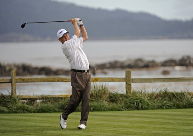 Jeff Sluman tees off on No. 18 during the Walmart First Tee Open at Pebble Beach Golf Links in Pebble Beach, California.