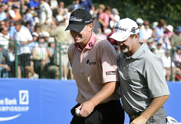 Steve Stricker and Jerry Kelly walk off the 18th green after the third round of the Deutsche Bank Championship.