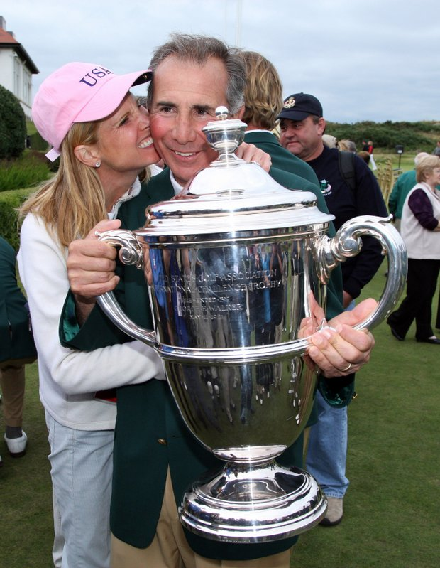 Buddy Marucci gets a kiss from his wife after winning the 2007 Walker Cup.