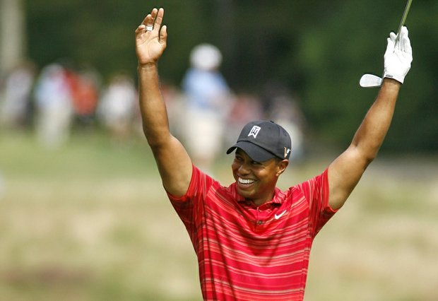 Tiger Woods celebrates after holing out for eagle on the par-4 sixth hole at TPC Boston.
