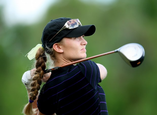 Megan McChrystal of LSU watches her tee shot at No. 8.