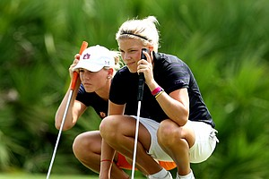 LSU's Amalie Valle, right, and Auburn's Carlie Yadloczky line up their putts.