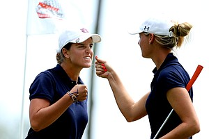 Patricia Sanz, left, and Carlie Yadloczky, right, of Auburn celebrate at No. 17.