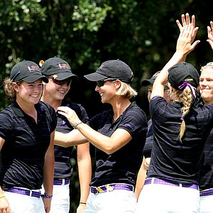 LSU celebrates after Mary Michael Maggio won her match.