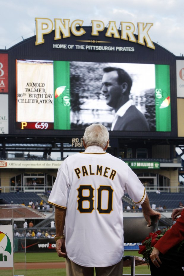 Arnold Palmer watches a video tribute to his career before a baseball game between the Pittsburgh Pirates and Chicago Cubs in Pittsburgh, Tuesday, Sept. 8, 2009. Palmer, a native of nearby Latrobe, Pa., was at the park for a celebration of his 80th birthday on Sept. 10.