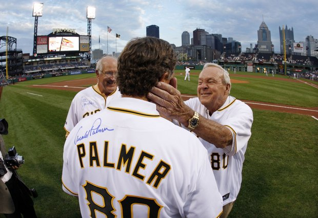 Arnold Palmer jokes with Peter Jacobsen after autographing the back of his commemorative Pirates jersey as Pittsburgh Pirates broadcaster and former pitcher Steve Blass looks on before the Pittsburgh Pirates and Chicago Cubs game Sept. 8.