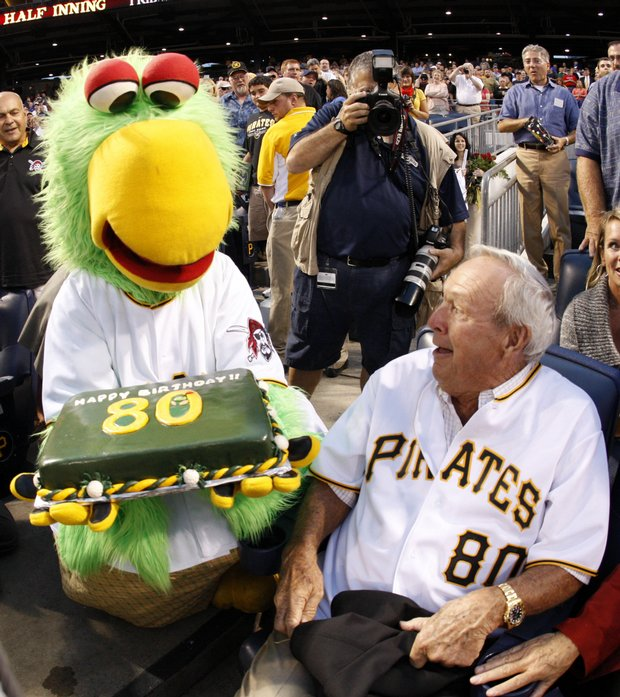 Arnold Palmer is surprised by the Pirate Parrot and a birthday cake in his seat behind home plate during the Pittsburgh Pirates and Chicago Cubs game Sept. 8.