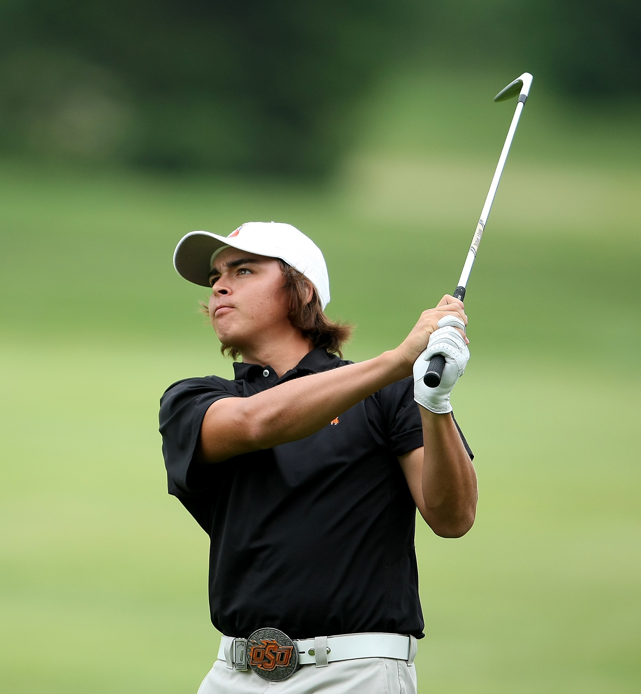 Oklahoma State's Rickie Fowler hits his second shot on the ninth hole during the 2009 NCAA Golf Championships at Inverness Club.