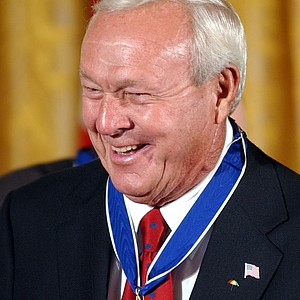 Arnold Palmer is all smiles after being presented with the Presidential Medal of Freedom, the nation's highest civil award, during a ceremony in the East Room of the White House, Wednesday, June 23, 2004. (AP Photo/Susan Walsh)