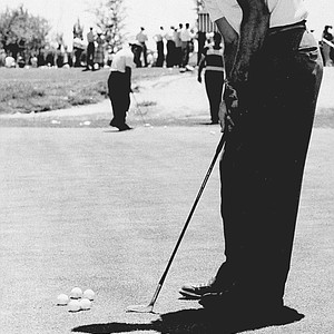 Arnold Palmer on the practice green at the NCAA Championship in Albuquerque, N.M. on June 26, 1950.