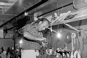 Arnold Palmer works on his clubs May 23, 1962, in the basement of his home in Latrobe, Pa.
