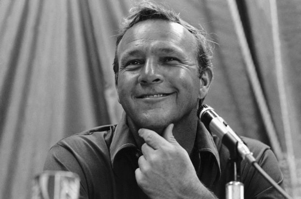 Arnold Palmer grins as he answers Jack Nicklaus' complaint about Merion Golf Club, site of the 1971 U.S. Open. Palmer spoke about pin placements great and Nicklaus' group.