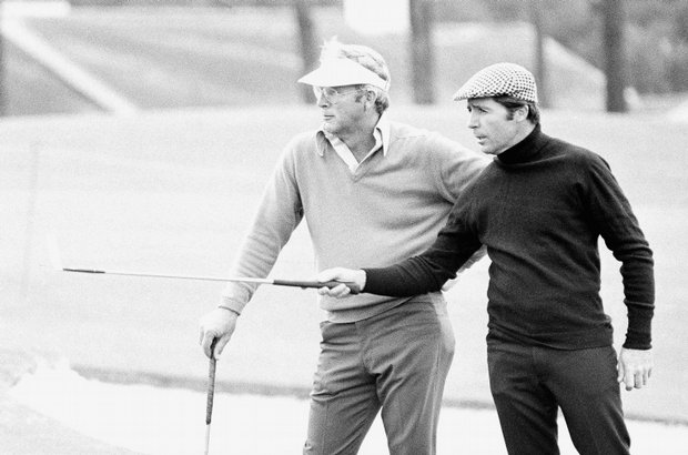 Arnold Palmer, left, and Gary Player wait during a Masters practice round on Monday, April 9, 1973.
