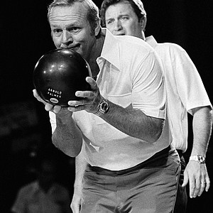 "Arnold Palmer in the finals of the ""Dynamic Duos"" bowling competition, Dec. 17, 1977 in Las Vegas. In background is his bowling partner, golfer Ray Floyd. They lost by six pins to the team of former football stars Jim Brown and Jim Taylor. (AP Photo/Wally Fong)"