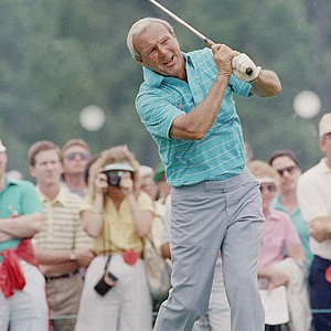 Arnold Palmer, four time winner of the Masters, is a highlight of the gallery during a practice session for the 1986 Masters. (AP Photo/Ric Feld)